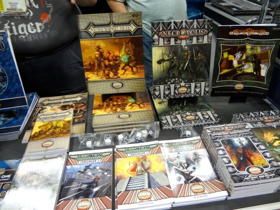 Roleplaying game manuals at Triple Ace Games booth at Gen Con 2012