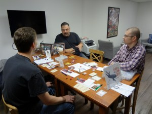 Two PCs and GM for Savage Worlds playing role-playing game at Vegas Game Day