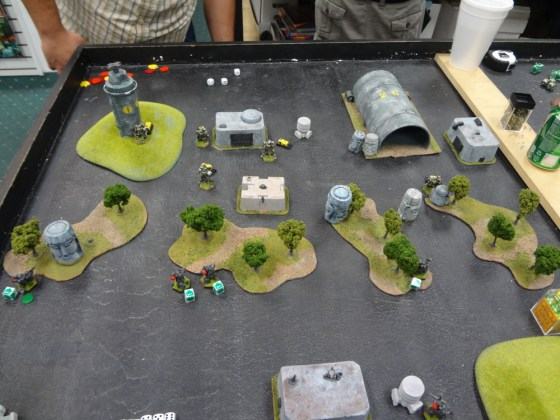 Overhead view of miniature battle with Heavy Gear Blitz Southern miniatures