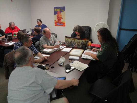 Pathfinder Society Players Cluster Around a GM at Vegas Game Day