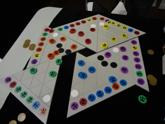 Six triangular pieces of Bin'fa playing board with army markers on them showing how game can be easily changed