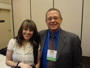 Jenny Bendel and Pierce Watters stand side by side at the 2013 GAMA Trade Show