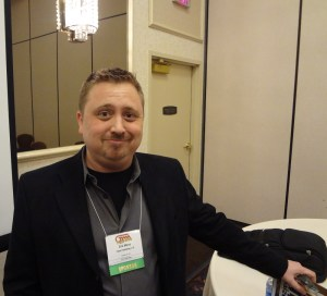 Paizo Publisher Erik Mona with pleased expression at GAMA Trade Show