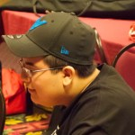 Baseball cap wearing Heroclix player Alex Pereda
