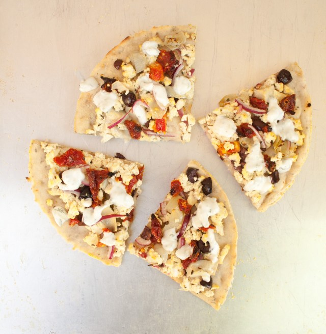 Tofu Feta and Sun-Dried Tomato Pizza with Vegan Tzatziki - Are you looking for something different for pizza night? This Greek inspired vegan pizza will hit the spot!