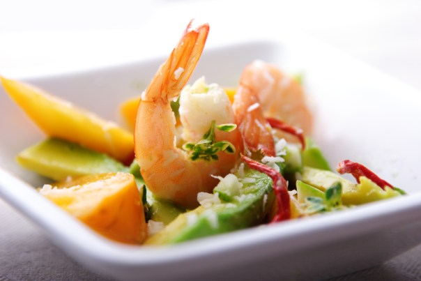 salad or apetizer with shrimp,coconut,avocado mango and herbs