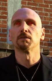 Ken Feinberg in Charmed as the Demon in Black. Look at those eyes!