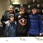 Crestmont Community Association President and his boys with Hitmen player #2 Jake Bean