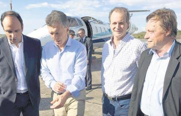 Varisco, a la derecha, con Macri.