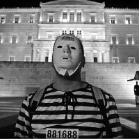Greek Protestors dressed as Prisoners before Parliament