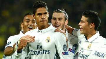 Real Madrid's French defender Raphael Varane (C) reacts after scoring during the UEFA Champions League first leg football match between Borussia Dortmund and Real Madrid at BVB stadium in Dortmund, on September 27, 2016. / AFP / Odd ANDERSEN        (Photo credit should read ODD ANDERSEN/AFP/Getty Images)