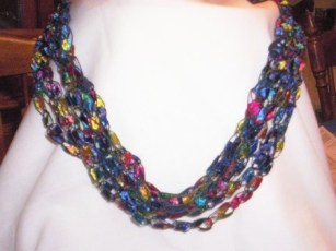 http://grammiepammie.wordpress.com/crocheted-necklace-from-trellis-ribbon/