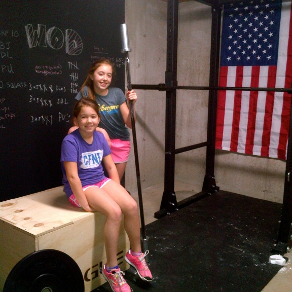 The Ranaldi girls getting ready for a workout at their home gym.
