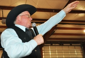 Darrell Kraupie, of Kraupie's Real Estate Auctioneers, Bridgeport, calls for bids the auction at the rodeo team's Black Tie Calf Fry at the Dawes County Fairgrounds Saturday, February 19. — Photo by Vera Ulitina