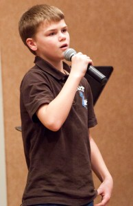 "Colton Burpo, 12, author of ""Heaven is for Real for Kids"" speaks at the presentation Friday. — Photo by Kinley Q. Nichols"