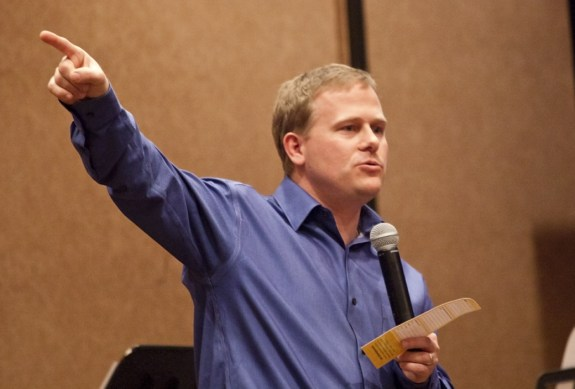 "Todd Burpo, author of ""Heaven is for Real"" gestures during the presentation Friday. — Photo by Kinley Q. Nichols"