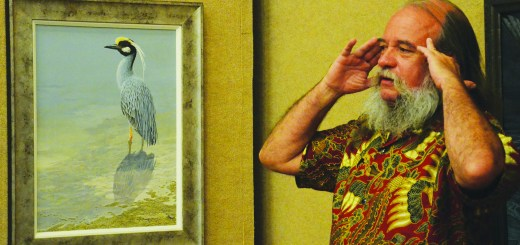 Carel Brest van Kempen, master animal artist, speaks about his paintings Monday during his presentation. —Photo by Teri Robinson