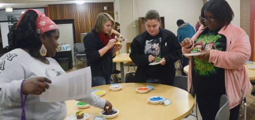 During the RLA sponsored event, Diversity Cupcakes, Tuesday, in the Gold Room, a group of girls pick up candy that has a label in front of it with a certain height written on it.---Photo by Sara Tweet