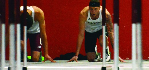 Matt Klein, junior of Scottsbluff, lines up on his blocks for the 60-meter hurdles event Saturday during the RMAC Indoor Track and Field Championships at the NPAC.--Photo by Jordyn Hulinsky