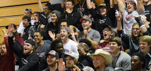 The CSC football team cheers on teammates particpating in a basketball shootout, Tuesday, during the Homecoming Pep Rally in Armstrong Gymnasium.