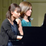 "Yen Nguyen, junior of Oita-Shi, Japan, and Talia Enevoldsen, senior of Potter, perform ""Con moto"" during the keyboard ensemble Saturday. —Photo by Alyssa Sanders"