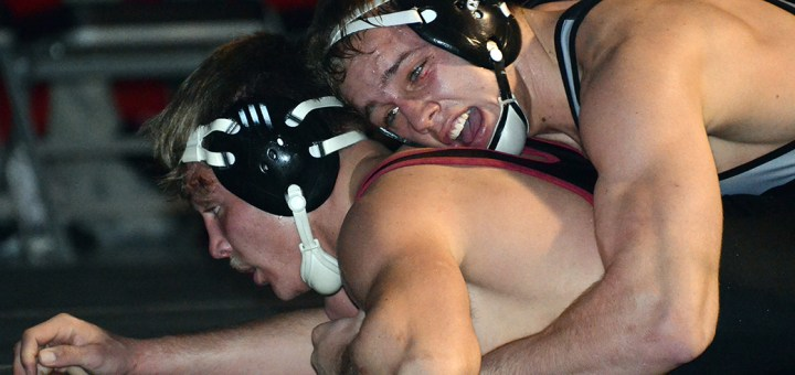 Western State Colorado University's Konnor Schmidt, redshirt freshman of Fort Collins, Colorado, holds down CSC's Willy Cogdill, redshirt freshman of Chadron, Friday during the 184-pound match at the NPAC. —Photo by Justine Stone