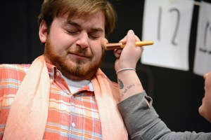 "Leo Haselhorst, junior of Randolph, is prepped with makeup Monday during play ""#7: The Art of Acting"" as part of a dress rehearsal of ""Too Much Light Makes The Baby Go Blind,"" in the Black Box Theatre. —Photo by Jordyn Hulinsky"