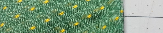 Green swiss dot fabric - basted