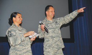"(U.S. Air Force photo by Robb Lingley) PETERSON AIR FORCE BASE, Colorado – Col. John Shaw, 21st Space Wing commander, and Chief Master Sgt. Idalia Peele, 21st SW command chief, announce the results of the 21st Space Wing unit effectiveness inspection May 19, 2015 at the base auditorium. The wing scored an ""Effective"" rating during the inspection."