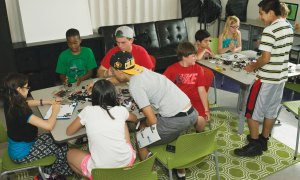 (U.S. Air Force photo by Airman 1st Class Rose Gudex) PETERSON AIR FORCE BASE, Colo. – Kids build a robot after learning about robotics during the STEM Camp held at the R.P. Lee Youth Center, July 21, 2015. The Science, Technology, Engineering and Mathematics subjects were the base of everything taught throughout the week long camp, in which kids learned new material and then used their hands to build projects based upon their new knowledge.