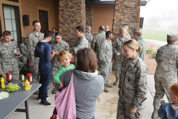 U.S. Air Force photo/2nd Lt. Darren Domingo The 2nd Space Operations Squadron and their families gather for a barbecue outside the Tierra Vista Community Center Friday, Oct. 2, 2015, following a briefing from 2 SOPS leadership explaining Space Mission Force. 2 SOPS leadership explained while SMF restructuring is vital for meeting military objectives, keeping connection with families is a crucial facet of the transition.