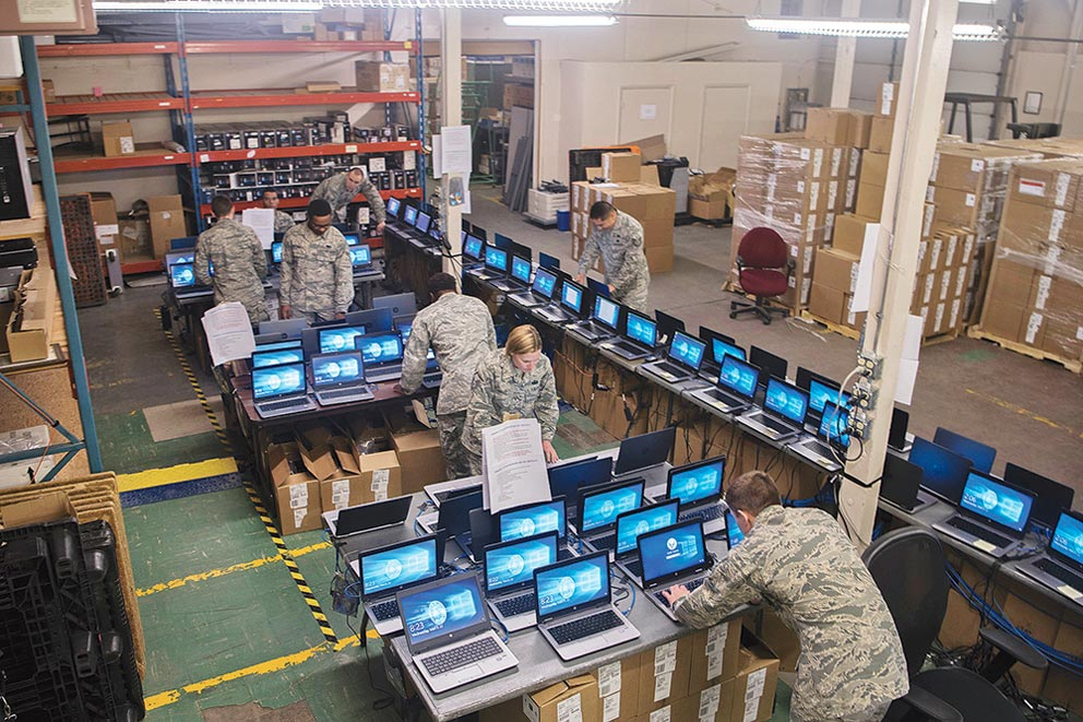 PETERSON AIR FORCE BASE, Colo. – Airmen of the 21st Communication Squadron work on several computers at once during the Windows 10 roll out project at Peterson Air Force Base, Colo., March 22, 2017. The Windows 10 roll out is part of a Department of Defense-wide mandate to update all computers across all services. The 21st CS has been working extra shifts to ensure that mandate is met well ahead of schedule on April 1.