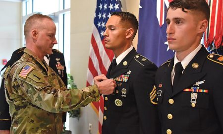 (U.S. Army photo by Dottie White) PETERSON AIR FORCE BASE, Colo. — Col. Tim Lawson, deputy commander for support, U.S. Army Space and Missile Defense Command/Army Forces Strategic Command, presents Army Commendation Medals to Staff Sgt. Christian Budeshefsky, SMDC's 2017 Noncommissioned Officer Best Warrior, and Spc. Samuel Leznik, SMDC's 2017 Soldier Best Warrior, during a ceremony at the command's Peterson Air Force Base, Colorado, Operations headquarters, May 11.
