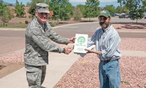 (U.S. Air Force photo by Steve Kotecki) PETERSON AIR FORCE BASE, Colo. — Col. Eric Dorminey, 21st Space Wing vice commander, is presented with a 2016 Tree City USA award by Andy Schlosberg from the Colorado State Forest Service during an Arbor day celebration on Peterson Air Force Base, Colo., June 20, 2017. This makes the 23rd year in a row that Peterson AFB has been named a Tree City USA since 1994.