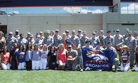 (Courtesy photo) ENGLEWOOD, Colo. — Thirty Airmen from the 21st Space Wing, Peterson Air Force Base, Colo., gather for a group photo June 14, 2017, at the Broncos Training Facility. The Denver Broncos football team hosted the airmen for a morale event.