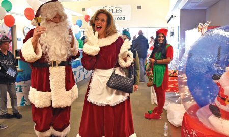 Santa Claus and Mrs. Claus make an appearance during the annual Children's Holiday Party at Schriever Air Force Base, Colorado, Dec. 2, 2017. Family and friends gathered together to participate in activities, greet Santa and register for prizes.