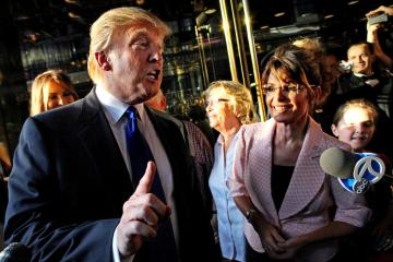 Donald Trump makes a point as he walks with former governor of Alaska Sarah Palin in New York City as they make their way to a scheduled meeting Tuesday, May 31, 2010. (AP Photo/Craig Ruttle)