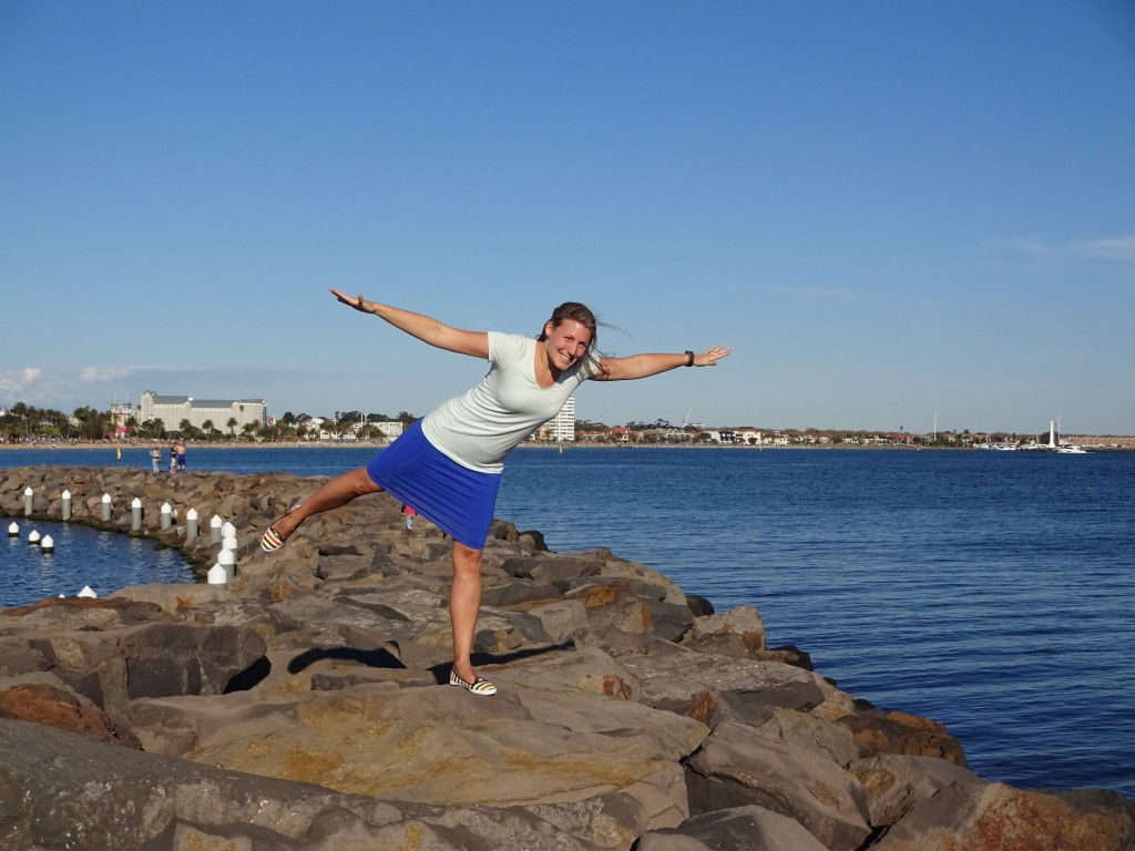 Playing on the rocks at St Kilda Pier