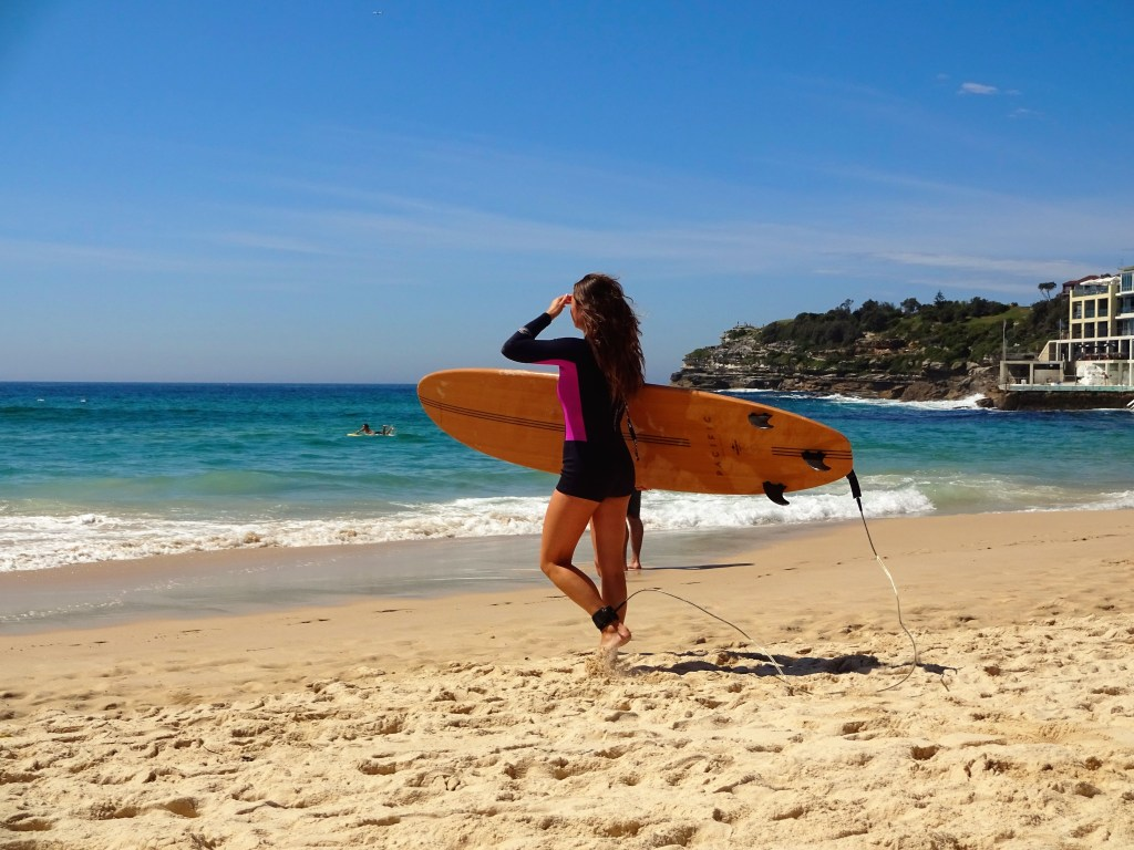 Surfing and bronzing are two popular pastimes at Bondi Beach!