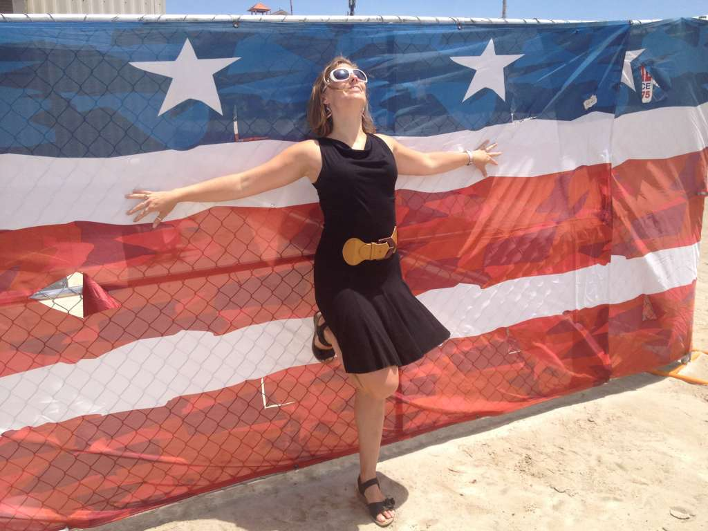 Posing in front of a huge American Flag