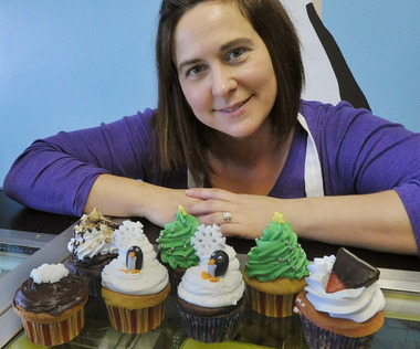 Antonella Gaglione is shown with some of her specialty cupcakes she makes at her Forks Township bakery. Gaglione will be competing in ArtsQuest's Cupcake Bowl.