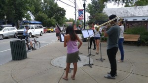 Lake George Music Festival volunteers perform an Art Attack in Bolton's Landing for passersby.