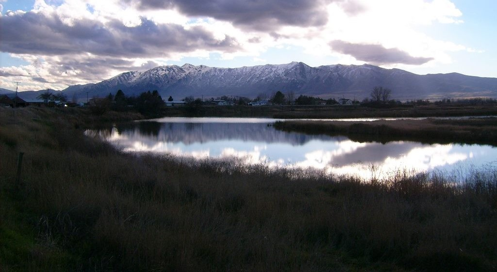 mountains with water in the foreground