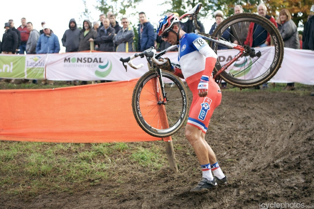 A disappointed Francis Mourey walks on the course after suffering a mechanical