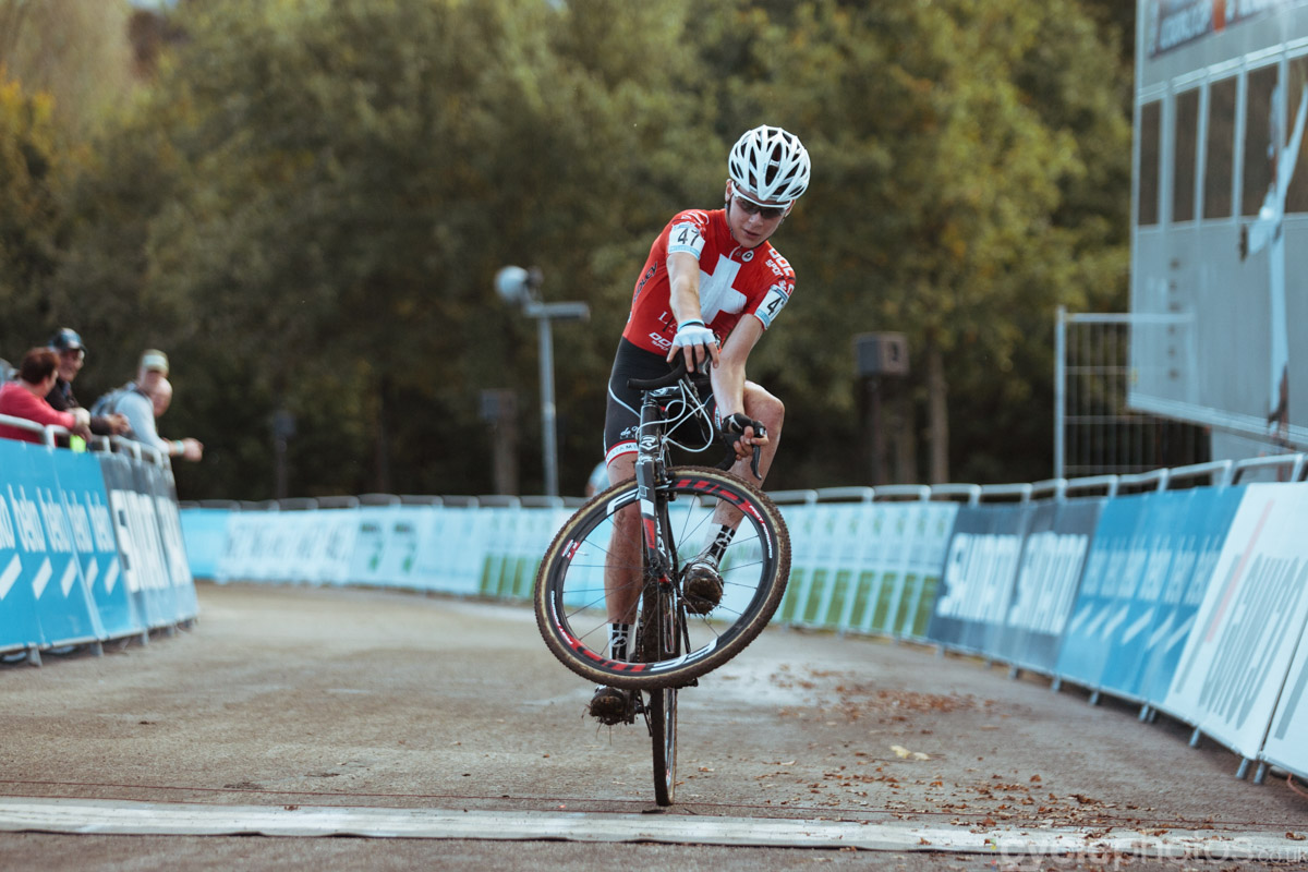 Johan Jacobs pulls a wheelie upon finishing the first cyclocross World Cup race of the 2014/2015 season in Valkenburg.