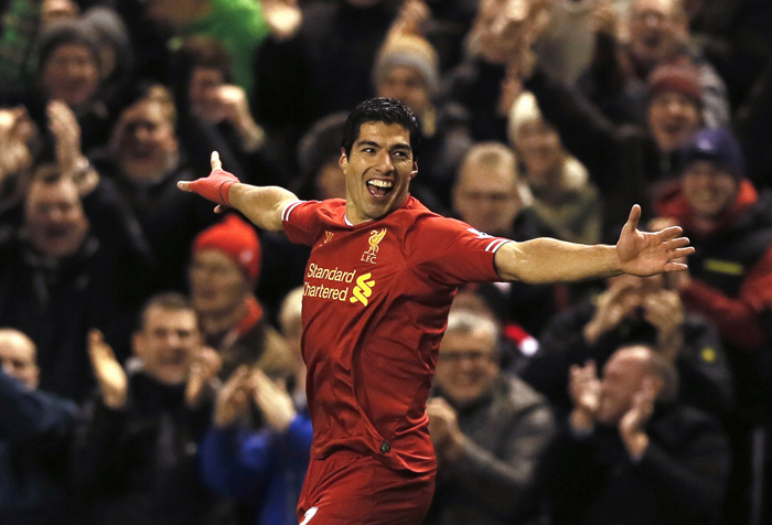 Suarez fires Liverpool as Arsenal, Chelsea, City win