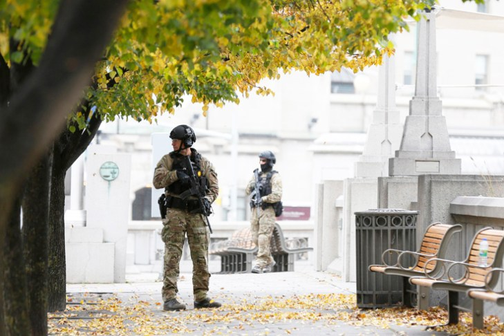 Security tight in Canada as police probe Parliament gunman's ties