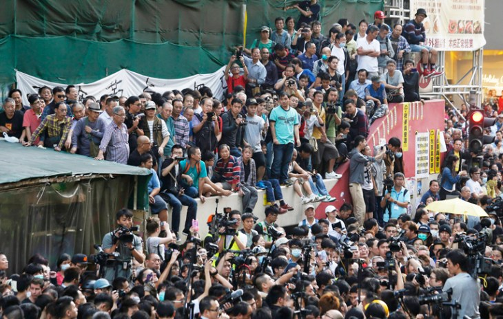 Scuffles break out as Hong Kong clears part of protest site (Update 1)