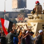 Three dead in attack and Islamist protests in Egypt