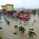 Record numbers evacuated in Malaysia's worst floods in decades